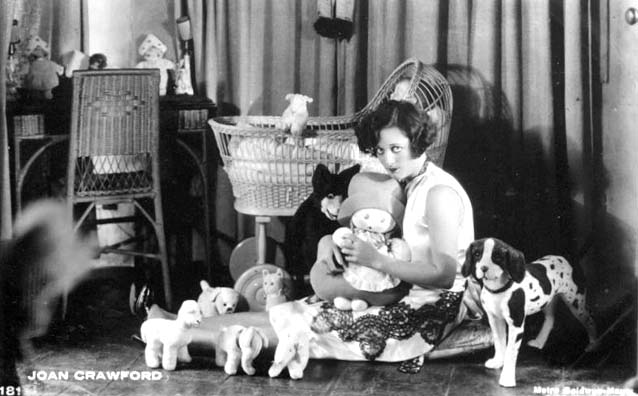 At home with her dolls, circa 1929.