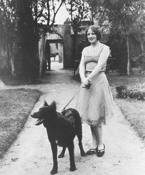 1926, with her Belgian police dog.