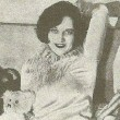 At home with dolls, appearing in a 1927 'Picture Play' magazine.