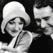 With John Gilbert on the set of 'Four Walls.'