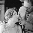 1928, with makeup icon Max Factor.