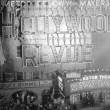 August 14, 1929. Two shots of the 'Hollywood Revue of 1929' premiere at the Astor Theatre in NYC. With live girls on the billboard.