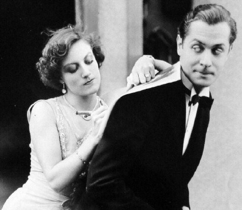1929. With Robert Montgomery on the set of 'Untamed.'