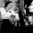 1931. Shot in Joan's dressing room by Hurrell. With Dietrich picture.