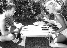 July 1931. Joan and husband Doug Fairbanks Jr. at home.