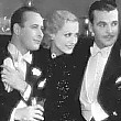 1931. This Modern Age. With Monroe Owsley to Joan's left and Neil Hamilton to right. Rest of players unknown.
