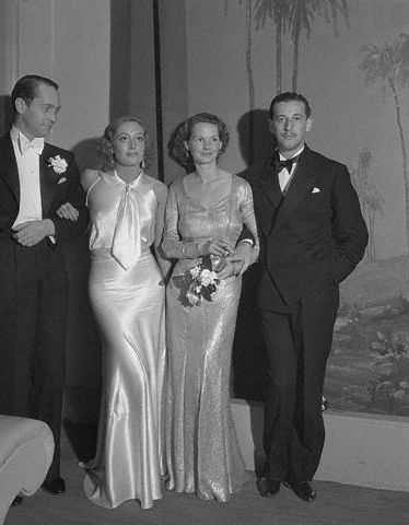 With Franchot Tone, unknown, and Adrian.