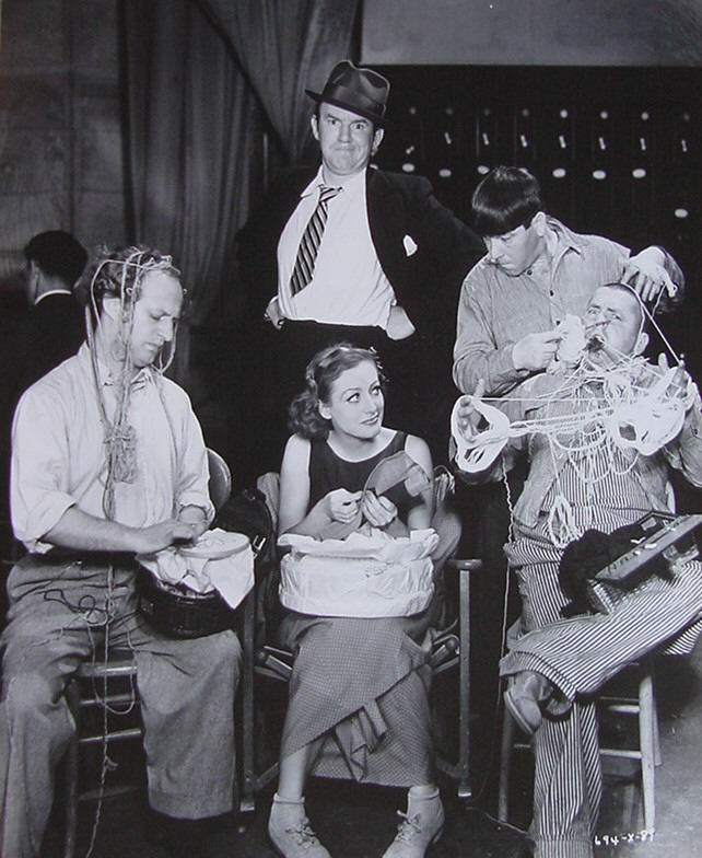 1933. On the set of 'Dancing Lady' with the Three Stooges.