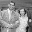 1934. On the set of 'Chained.' With Gable in center and two unknown.