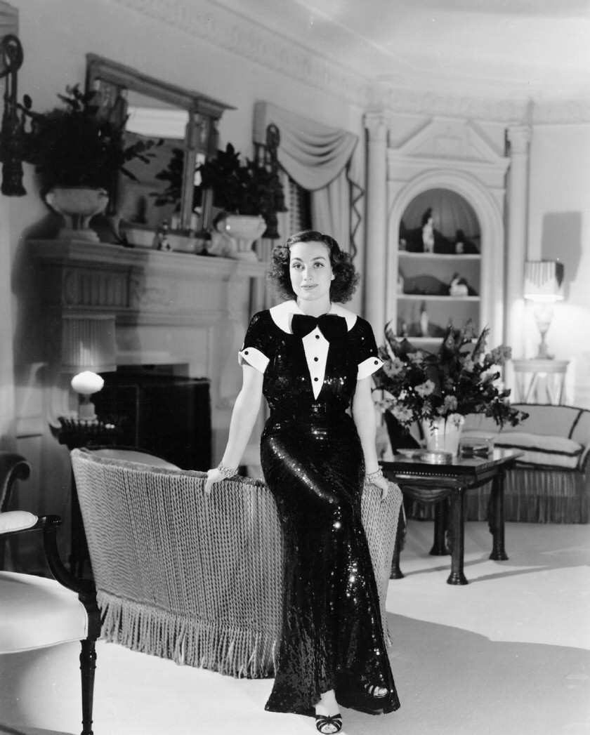 1936 at home, with dress by Hattie Carnegie.