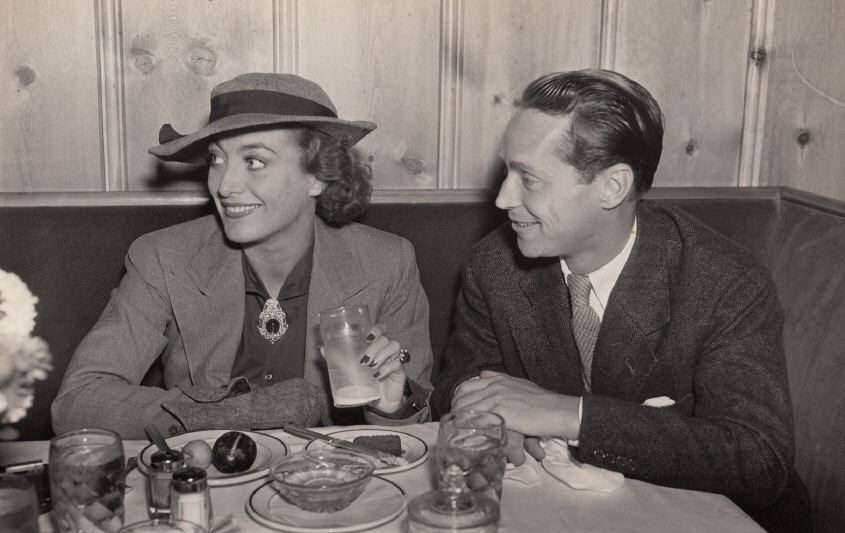December 1935. At Hollywood's Vendome Cafe with Franchot Tone. Shot by Hyman Fink.