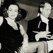 1937. At a studio Halloween party with husband Franchot Tone.