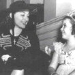 1938. With Shirley Temple on the set of 'Little Miss Broadway.'