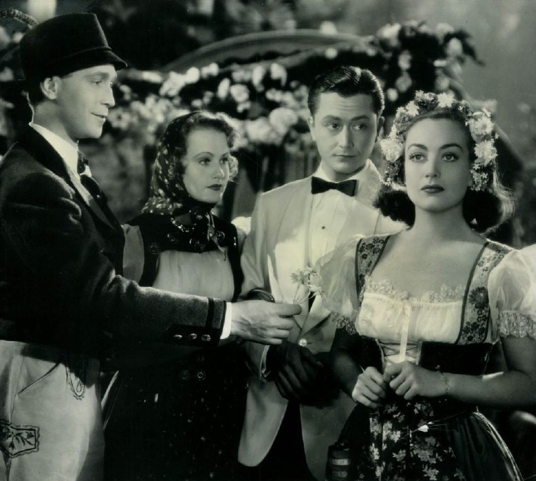 1937. 'The Bride Wore Red.' With Franchot Tone, left,