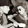 1938. At the races with husband Franchot Tone.