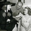 1938. On the set of 'Little Miss Broadway' with director Irving Cummings and Shirley Temple.
