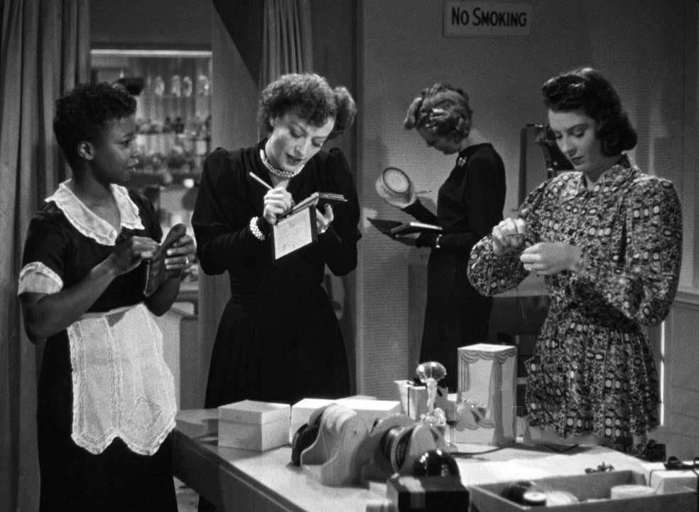1939. Screen shot from 'The Women' with Butterfly McQueen, left.