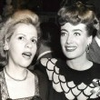 1943. Warners reception for Joan at NYC's Sherry-Netherland hotel, with Radie Harris.