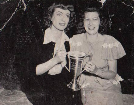 1947. On the set of 'Possessed' with a fan club member.