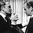 1941. Publicity for 'A Woman's Face,' with Conrad Veidt, left, and Melvyn Douglas.