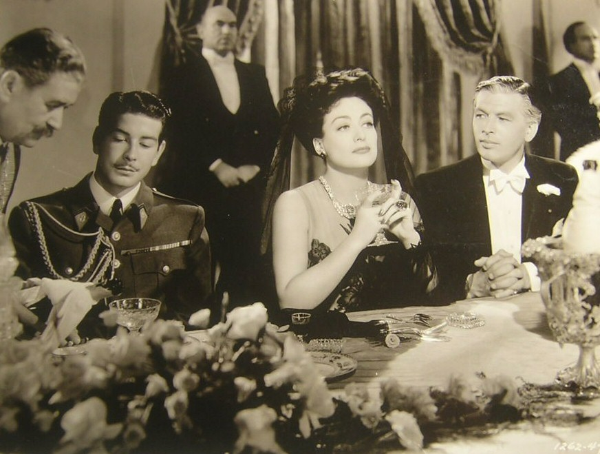 1942. 'Reunion in France.' With Philip Dorn at right.