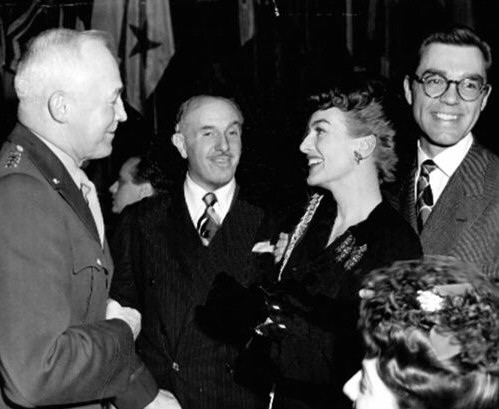 Circa 1944. A party for the military, with Jack Warner and husband Phillip Terry.