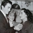 December 1945. With Gregory Peck and Kay Proctor, receiving the Golden Apple award.