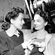 1945. On the set of 'Mildred Pierce' with Ann Blyth.