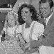 April 1945. Joan, Phillip, and Christina pose for troops at Joan's Brentwood home.