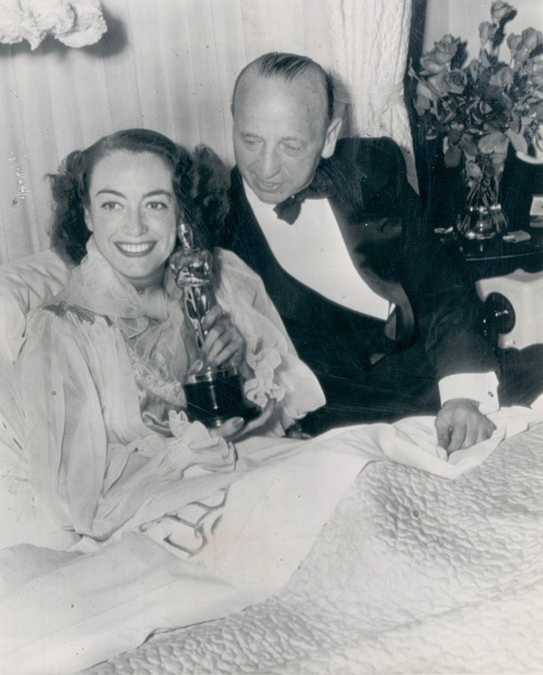 March 7, 1946. At home with Oscar and director Mike Curtiz.
