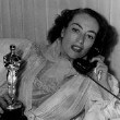 3/7/46. At home with her new Oscar.