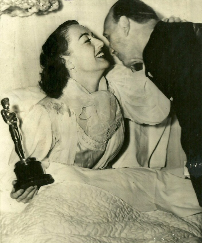 3/7/46. At home with her Oscar and director Mike Curtiz.