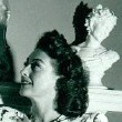 1946. Joan at home, gazing up at...herself!
