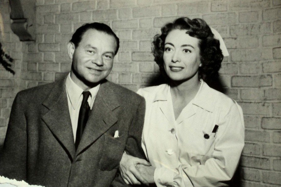 1947. On the set of 'Possessed' with Swedish correspondent Mishel Green.