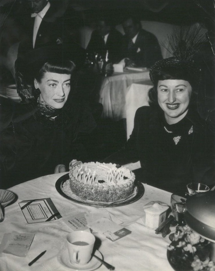 April 1948. With Warners publicist Lucia Perrigo at Chicago's Pump Room.