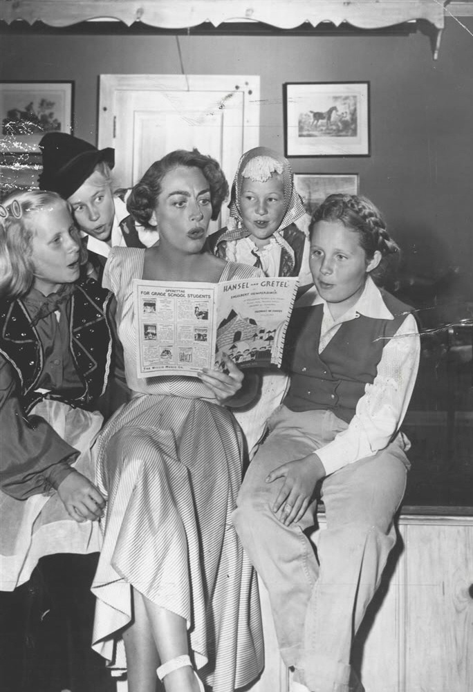 February 1950. Joan directs Christina's Brentwood Brownie troop in a 'Hansel and Gretel' operetta. From left: Christina, Carole Baker, Cynthia Shaw, Jill Marble.