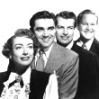 1950. Publicity for 'The Damned Don't Cry.' From left: Joan, Steve Cochran, Richard Egan, David Brian.