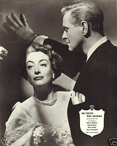 1950. 'The Damned Don't Cry.' With David Brian. (Thanks to Susanne.)