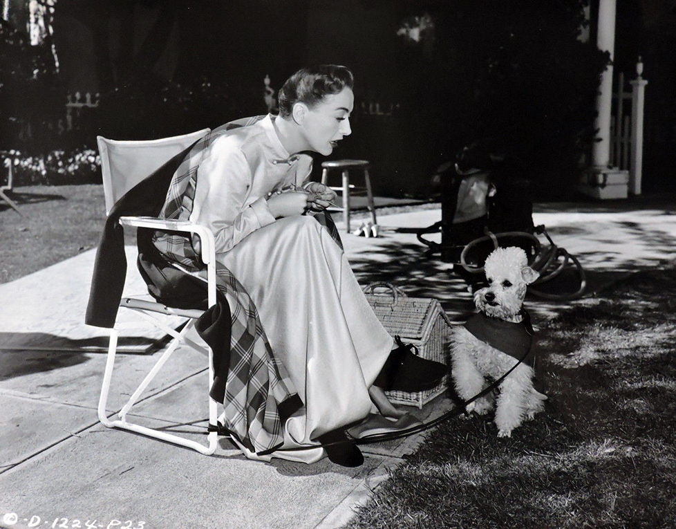 1950. On the set of 'Harriet Craig' with Cliquot.