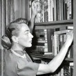 Circa 1950, at home with books.