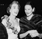 Joan Crawford and Gene Tierney, 1949.