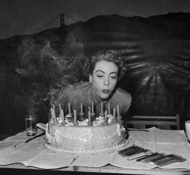 1952. Happy birthday to Joan on the 'Sudden Fear' set.