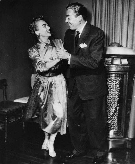 July 1952. With Cesar Romero at his apartment.