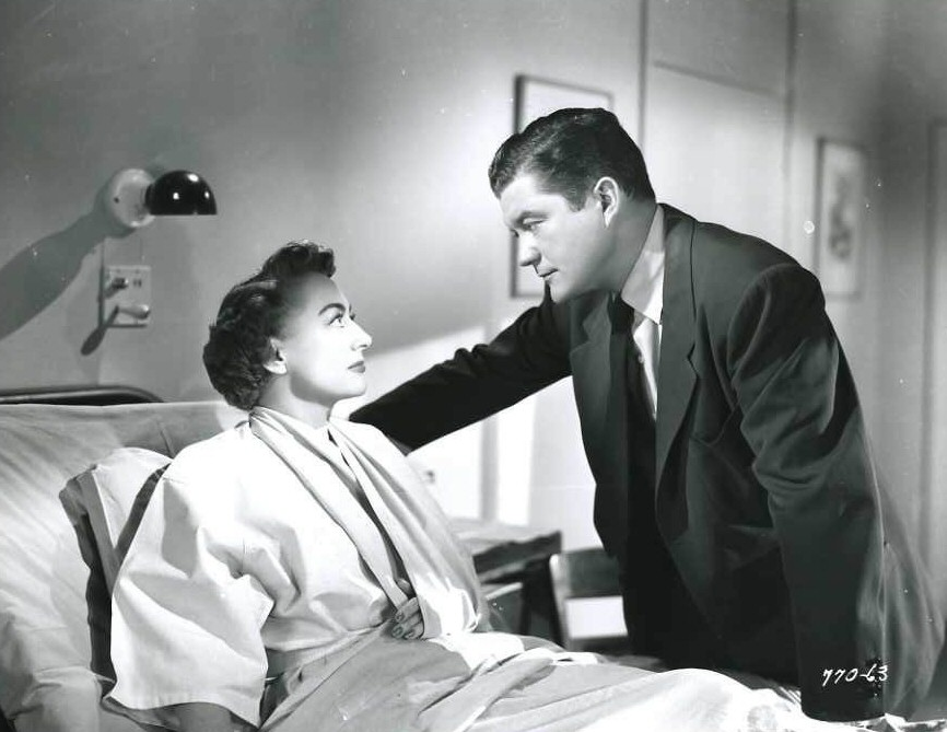 1952. Film still from 'This Woman Is Dangerous.' With Dennis Morgan.