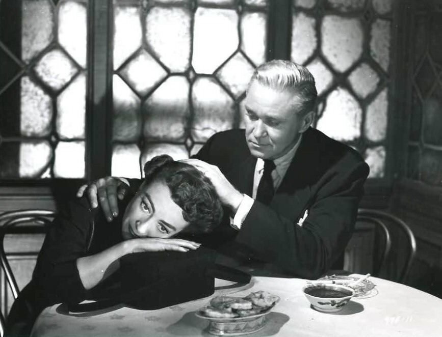 1952. Film still from 'This Woman Is Dangerous' with David Brian.