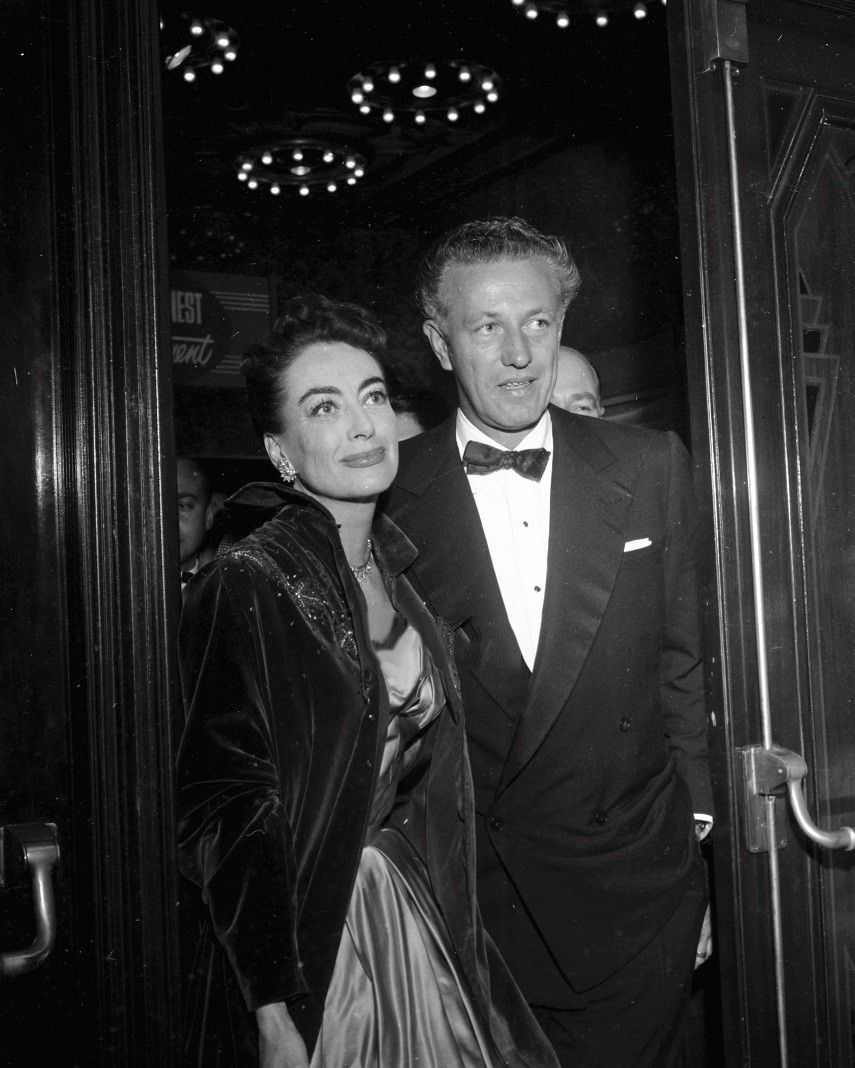 November 1953. At the premiere of 'Torch Song' with 'Johnny Guitar' director Nicholas Ray.