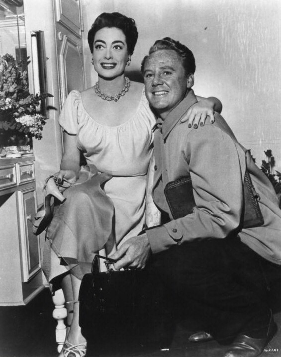 1953. On the set of 'All the Brothers Were Valiant' with Van Johnson.