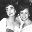 4/6/54. With Debbie Reynolds at unknown premiere.