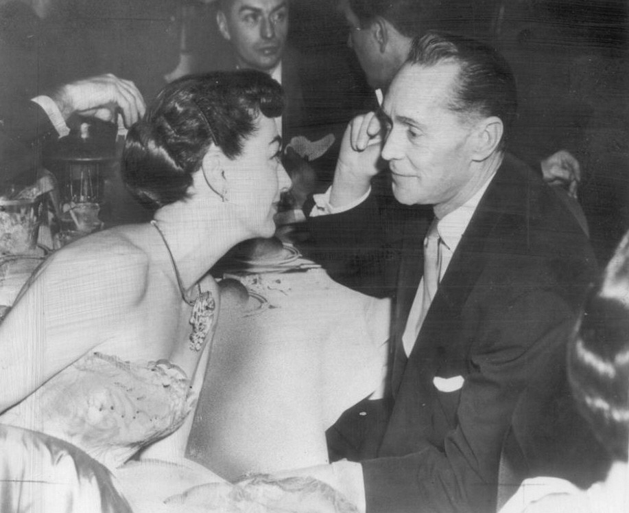 1954. With ex-husband Franchot Tone.