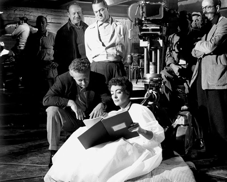 1954. 'Johnny Guitar.' On the set with director Nick Ray.